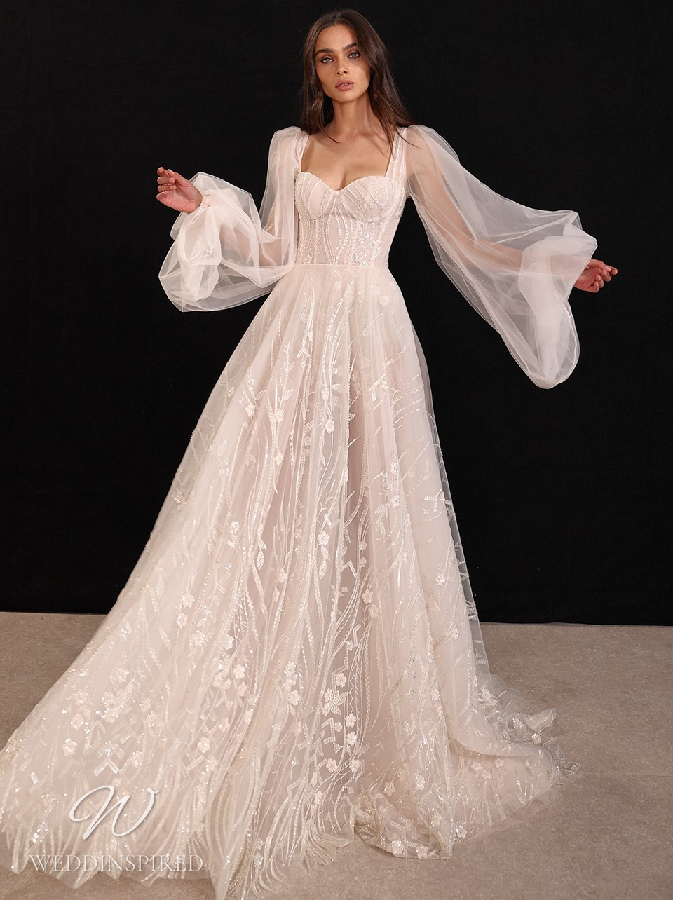 A Galia Lahav 2022 blush lace and tulle A-line wedding dress with long sleeves