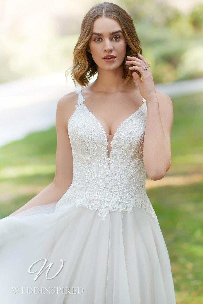 A Kenneth Winston 2021 lace and chiffon A-line wedding dress with a v neckline