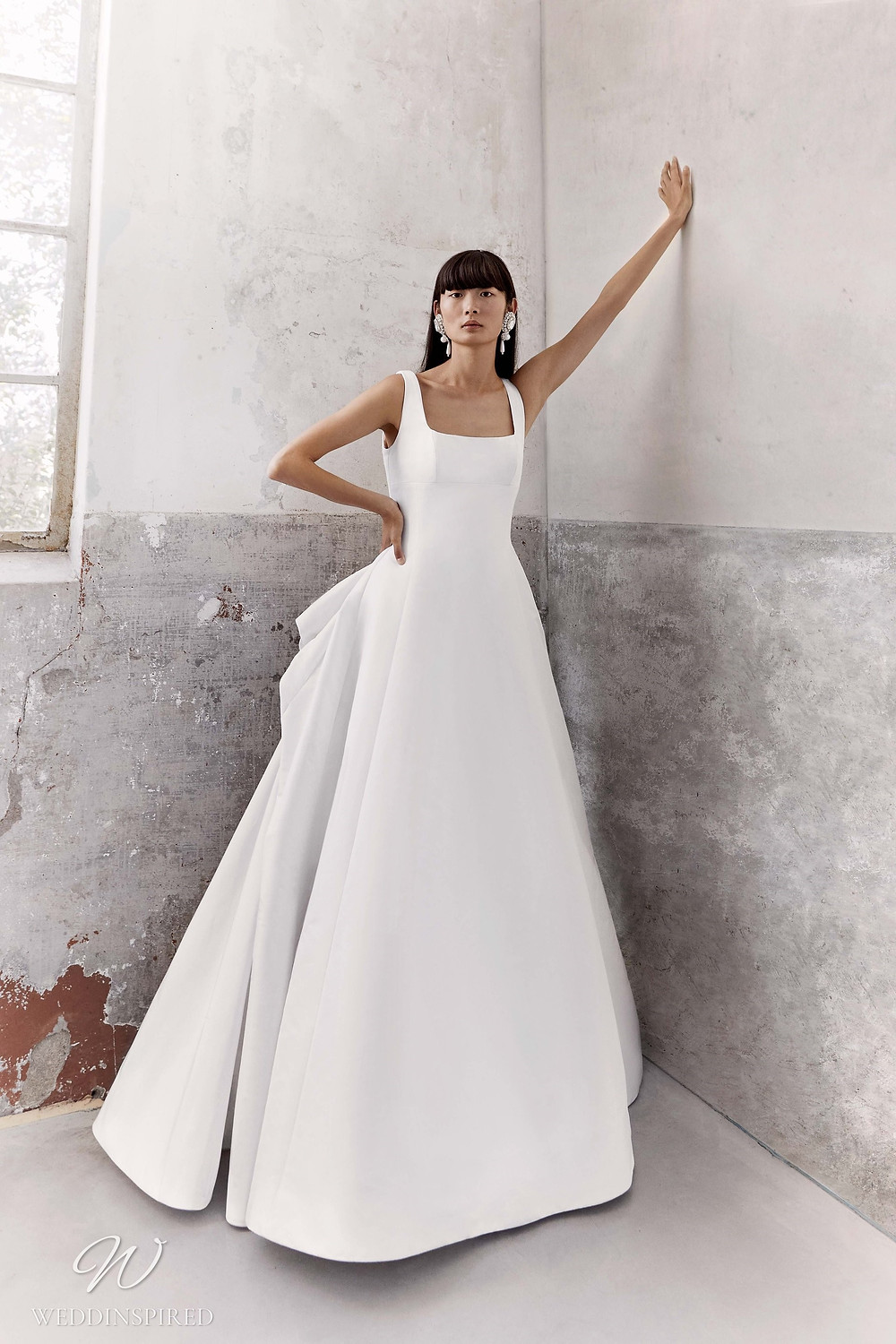 A Viktor & Rolf Fall/Winter 2021 simple ball gown wedding dress with straps and a square neckline