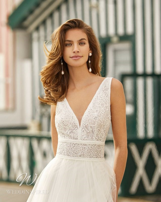 A Rosa Clara 2021 lace and tulle A-line wedding dress with a v neck