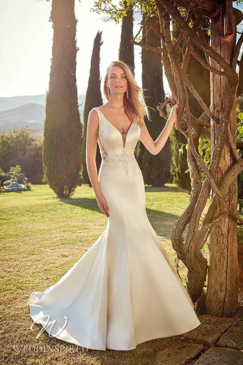 An Eddy K 2021 ivory satin mermaid wedding dress with a v neck