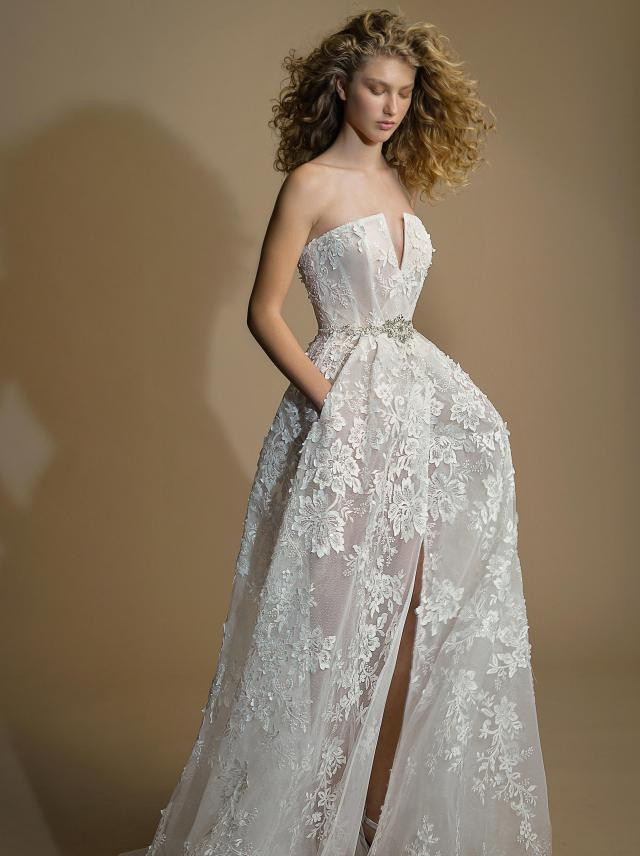 A Galia Lahav strapless mesh A-line wedding dress with pockets