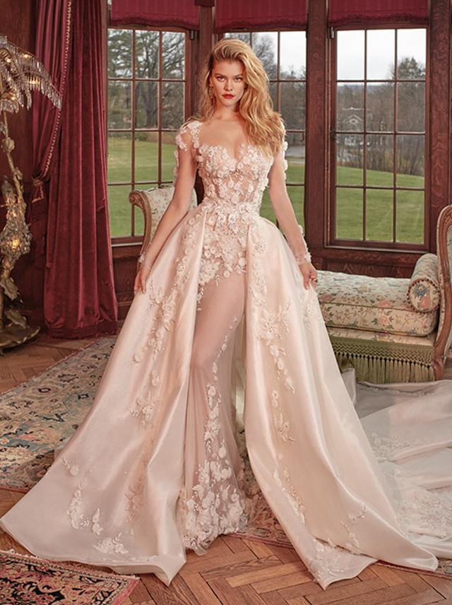 A blush ball gown wedding dress with detachable skirt and flowers