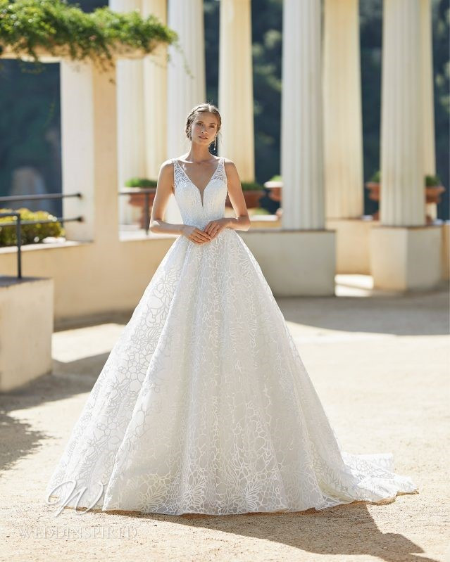 A Rosa Clara 2021 lace princess ball gown wedding dress with a v neck