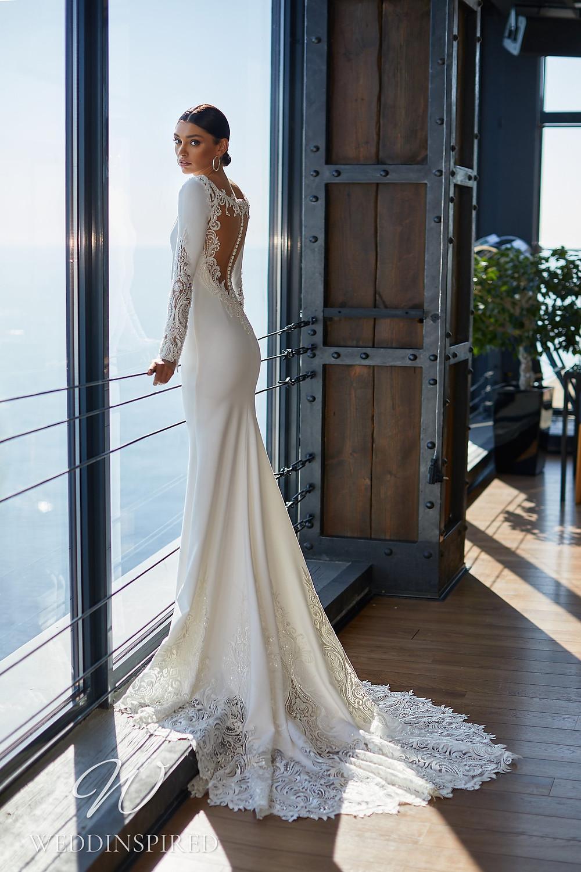 An Ida Torez 2021 backless satin and lace mermaid wedding dress