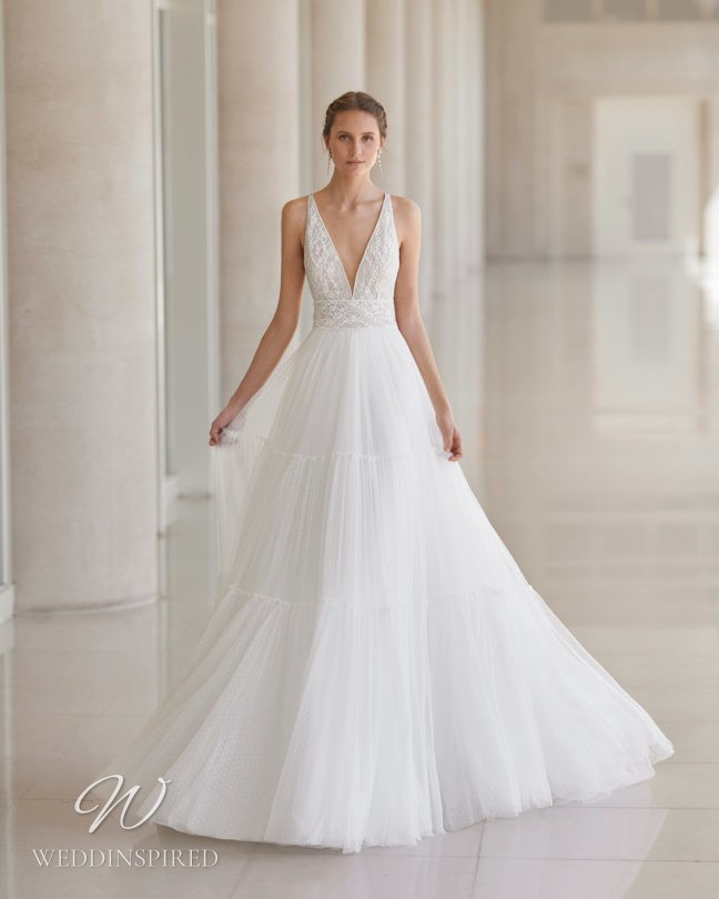 An Aire Barcelona 2021 tulle and lace A-line wedding dress with a v neck