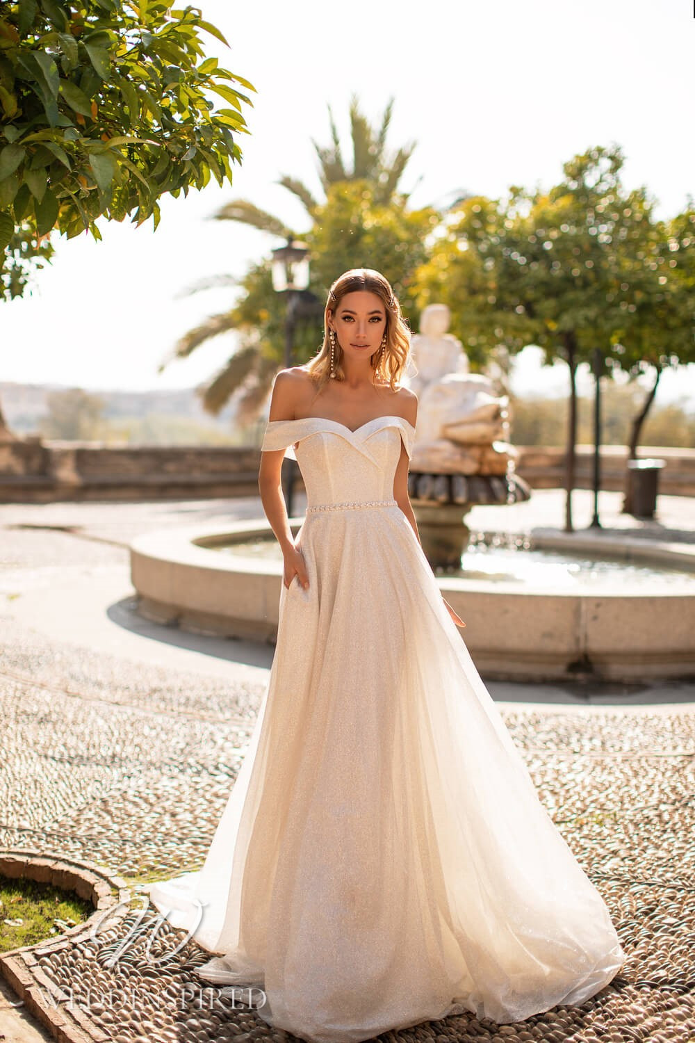 An Essential by Lussano 2021 sparkly blush off the shoulder A-line wedding dress