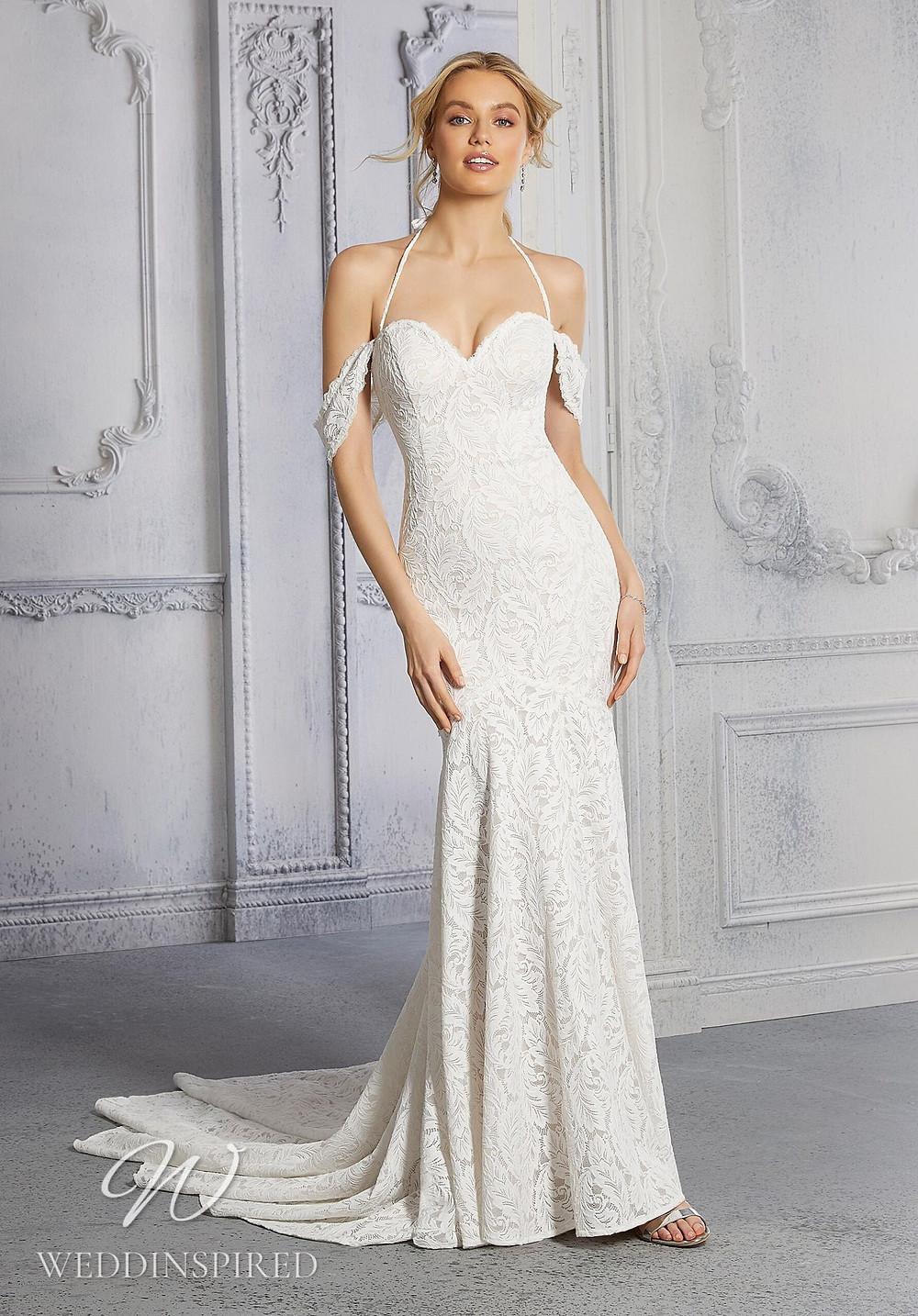 A Madeline Gardner lace off the shoulder mermaid wedding dress