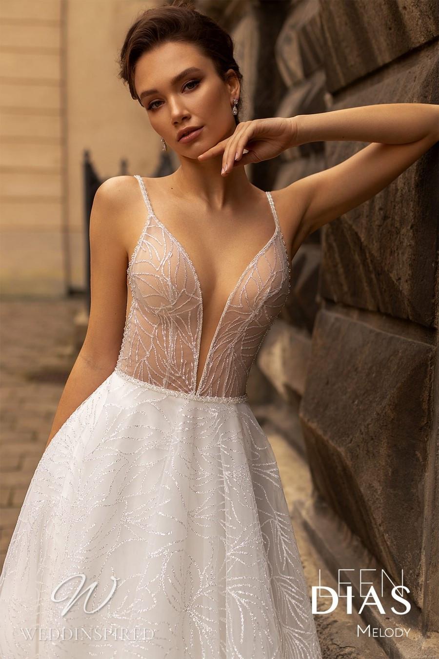 A Leen Dias 2021 tulle A-line wedding dress with a v neck