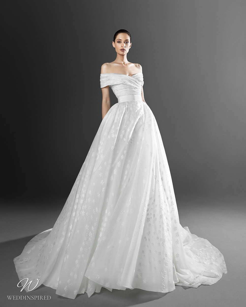 A Zuhair Murad ball gown off the shoulder princess wedding dress