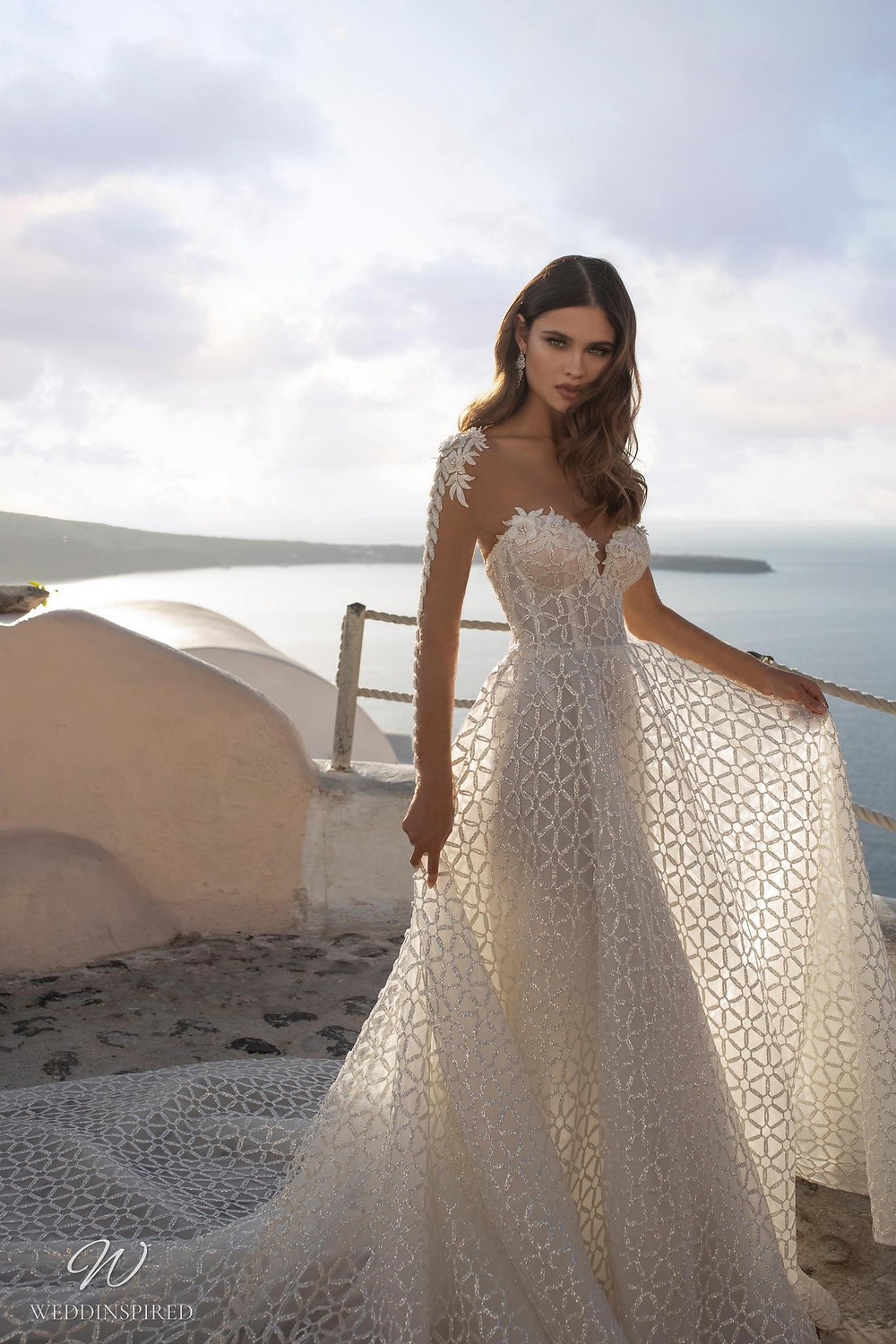 A Ricca Sposa sparkly lace A-line wedding dress with long lace illusion sleeves and a sweetheart neckline