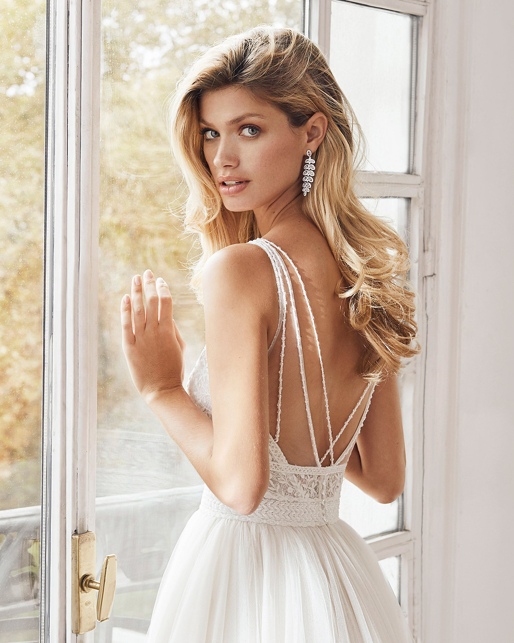 An Aire Barcelona 2020 lace and mesh A-line wedding dress with thin spaghetti straps and a low back