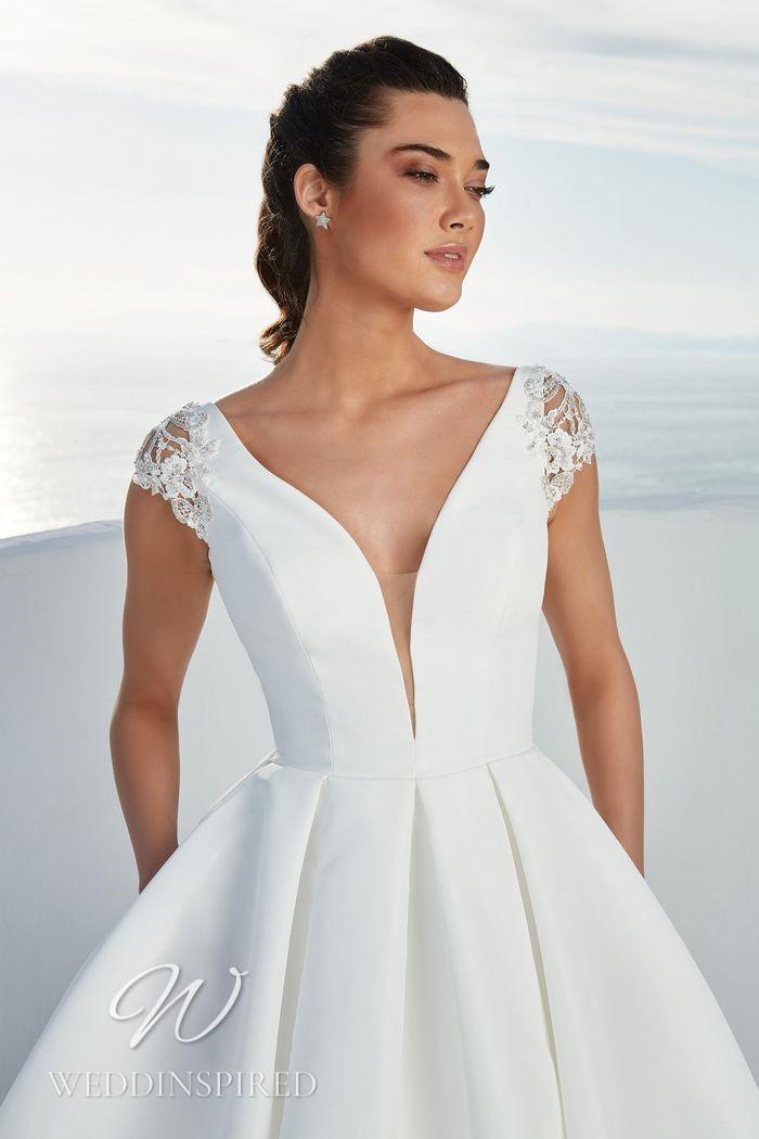 A Justin Alexander 2021 satin princess wedding dress with cap sleeves
