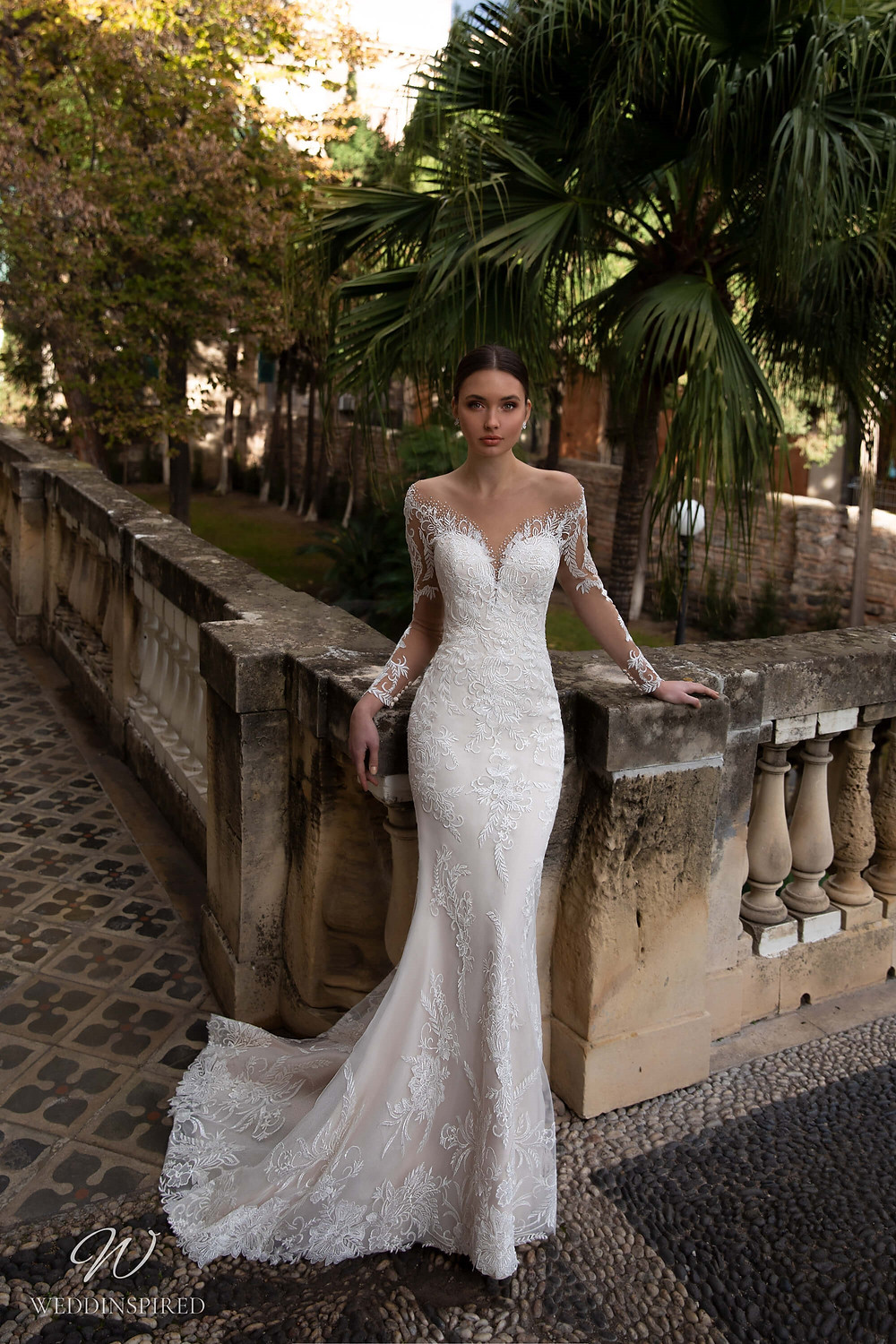 A Naviblue off the shoulder lace mermaid wedding dress with long sleeves
