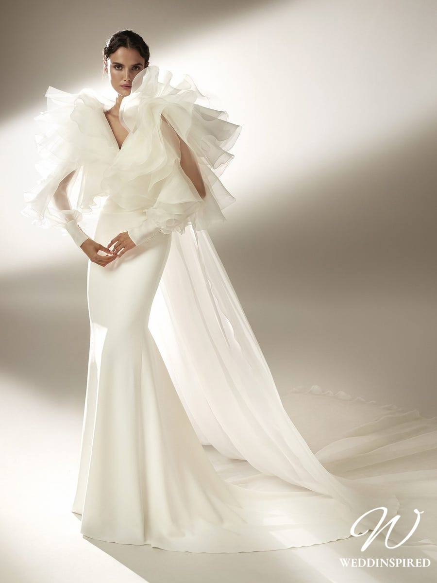 An Atelier Pronovias silk mermaid wedding dress with tulle ruffles and a cape