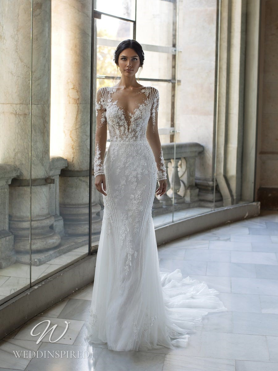 A Pronovias Privée 2021 lace and tulle mermaid wedding dress with a v neck and long illusion sleeves