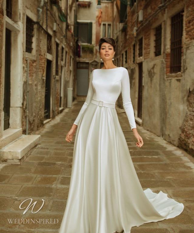 A Rara Avis 2021 simple modest vintage silk A-line wedding dress with long sleeves and a high neck