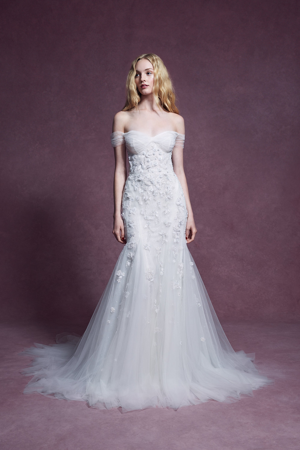 A Marchesa 2020 soft, flowy off the shoulder, tulle mermaid wedding dress with flowers