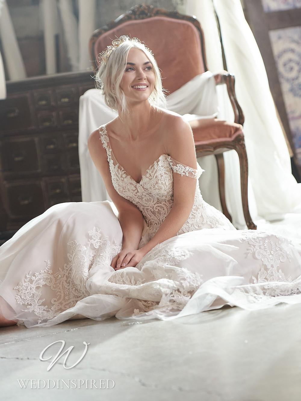 A Maggie Sottero 2021 lace A-line wedding dress