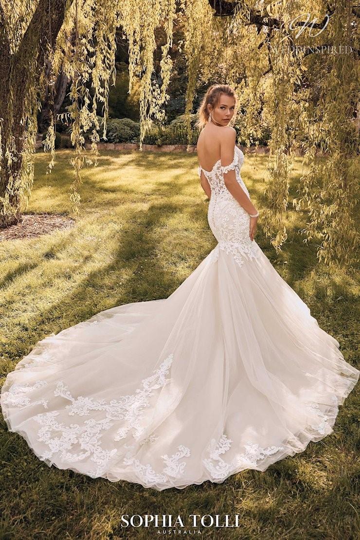 A Sophia Tolli blush off the shoulder lace mermaid wedding dress with a train