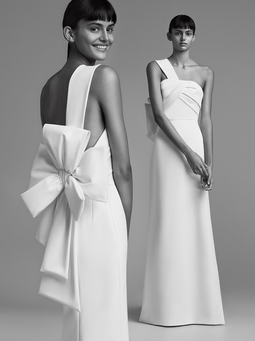 A clean, one-shoulder sheath wedding dress, with a large bow