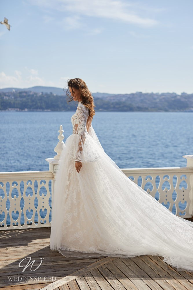 A Milla Nova 2021 lace ball gown wedding dress with long sleeves and a high neckline