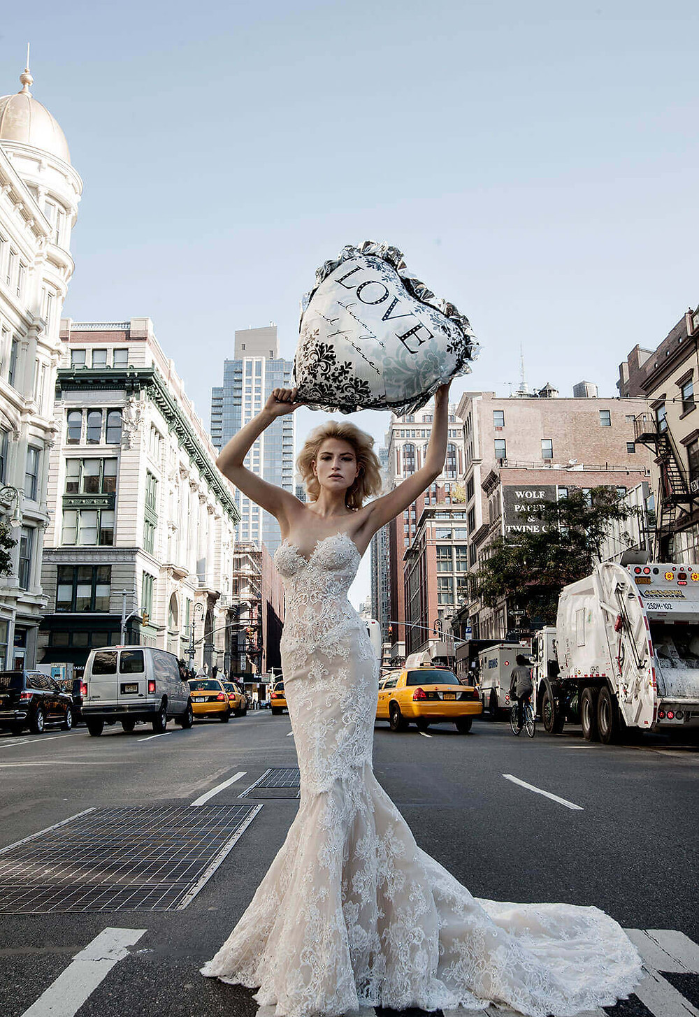 A Pnina Tornai strapless ivory lace mermaid fit and flare wedding dress