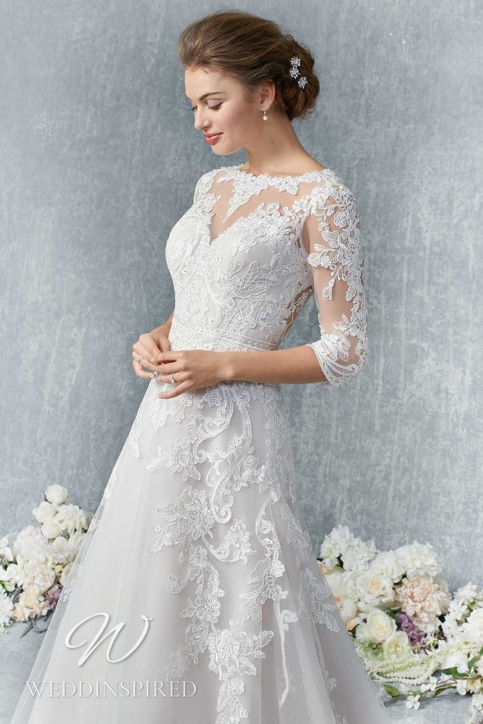 A Kenneth Winston 2021 lace A-line wedding dress with long sleeves