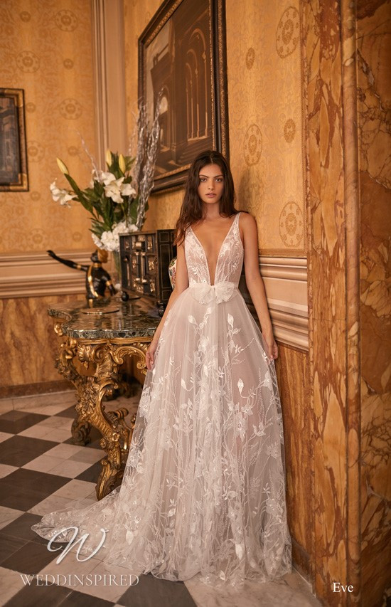 A Gali Karten lace and tulle flowy A-line wedding dress with a deep v neckline