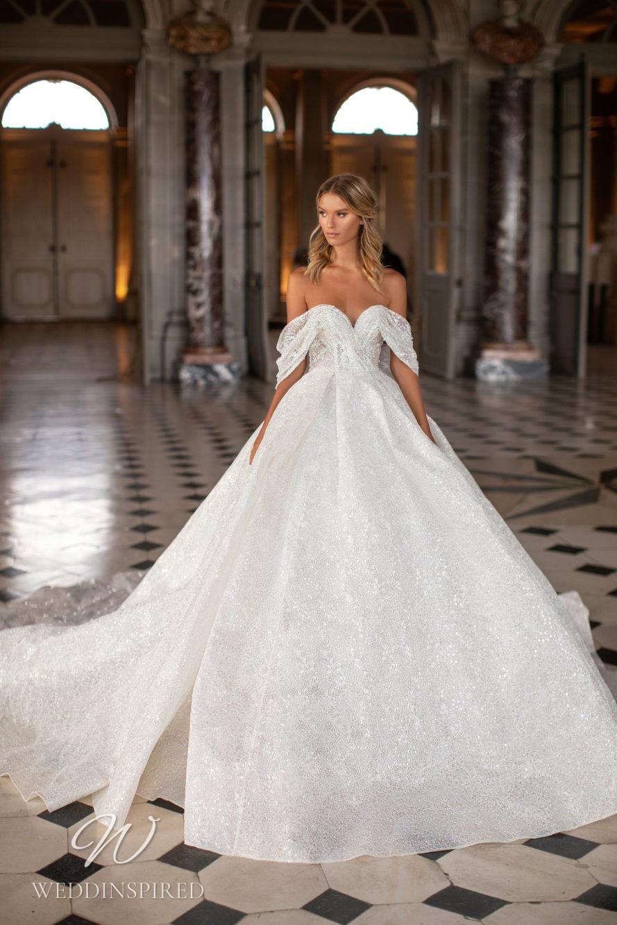 A Milla Nova off the shoulder princess ball gown wedding dress with crystals
