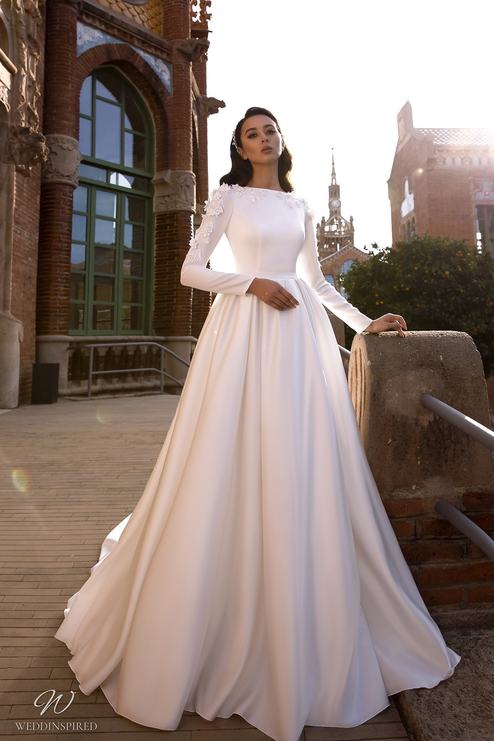 A Maks Mariano modest silk satin ball gown wedding dress with long sleeves