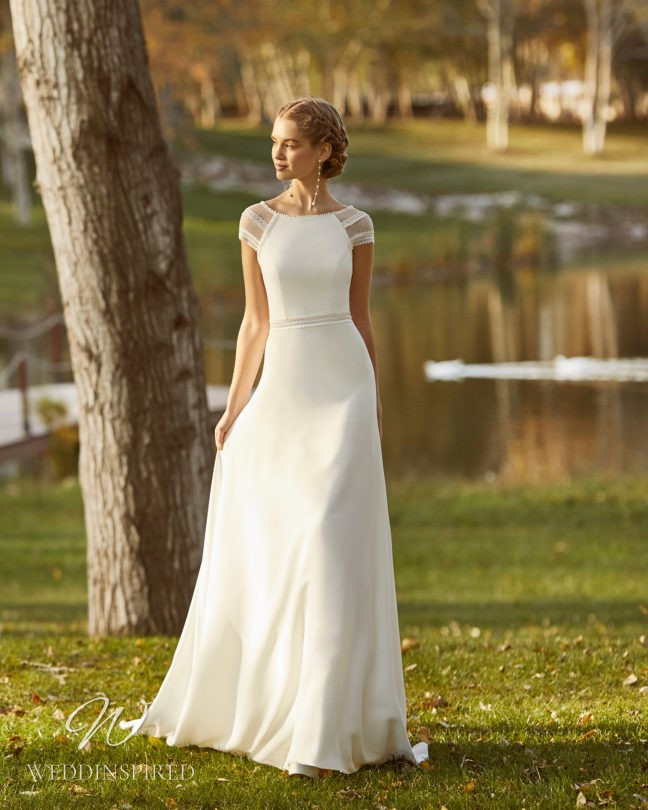 An Aire Barcelona 2021 flowy A-line wedding dress with cap sleeves