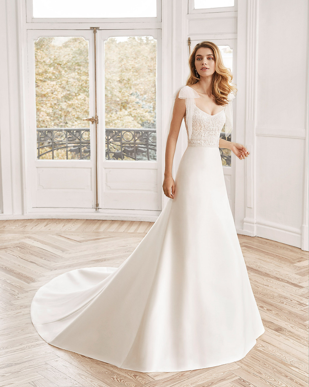 An Aire Barcelona 2020 lace and crepe A-line wedding dress with a train