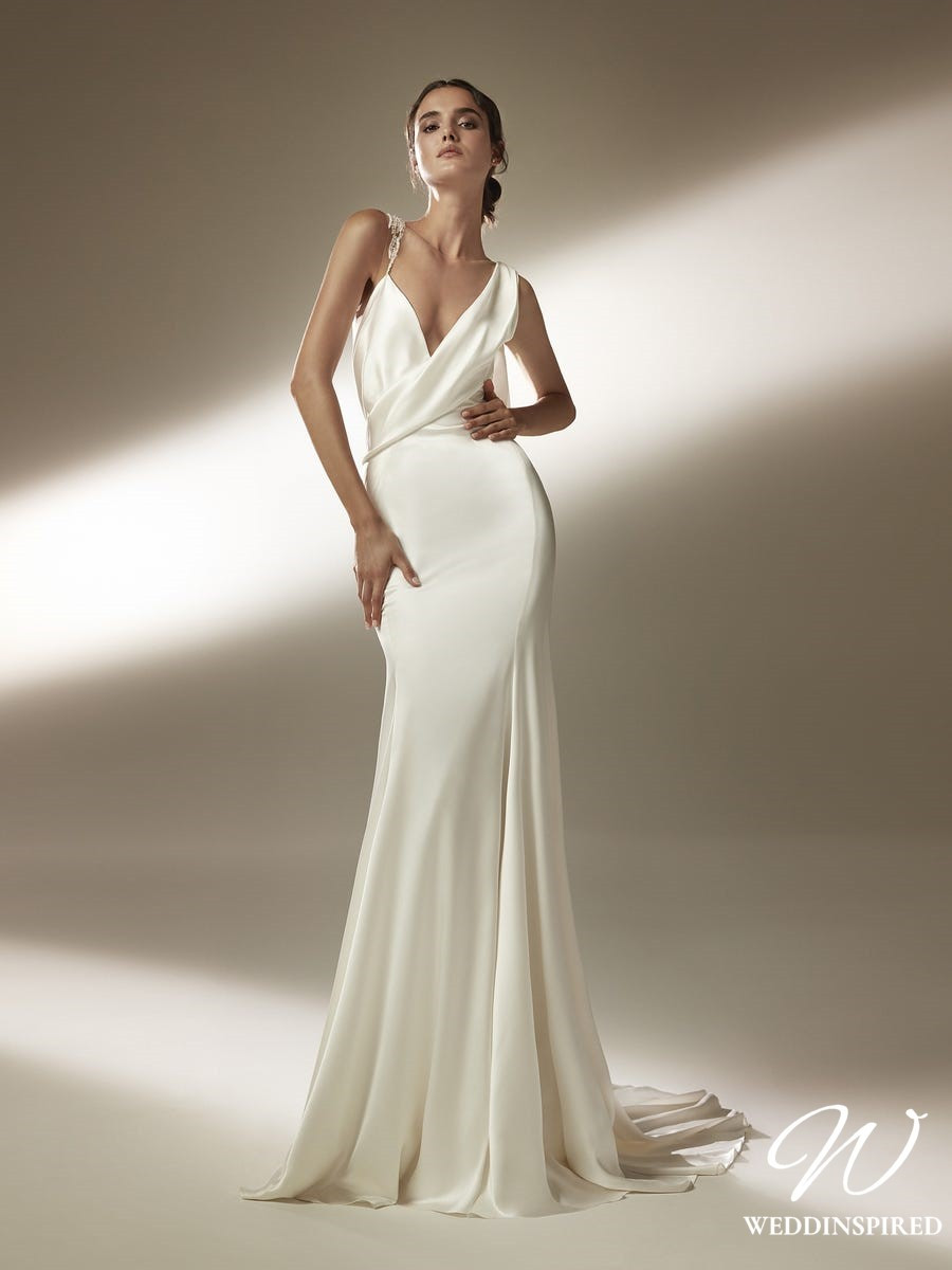 An Atelier Pronovias silk sheath wedding dress with a low v neckline and crystals