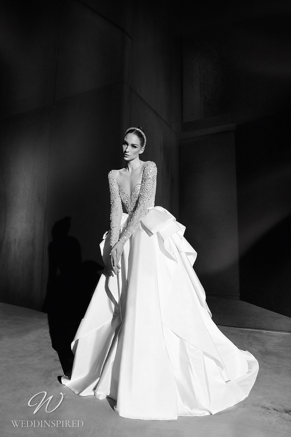 A Zuhair Murad Spring 2022 satin and mesh ball gown wedding dress with long sleeves