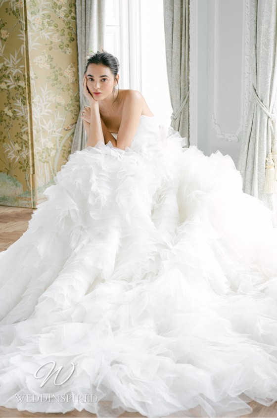 A Monique Lhuillier Fall 2021 strapless tulle A-line wedding dress with a ruffle skirt
