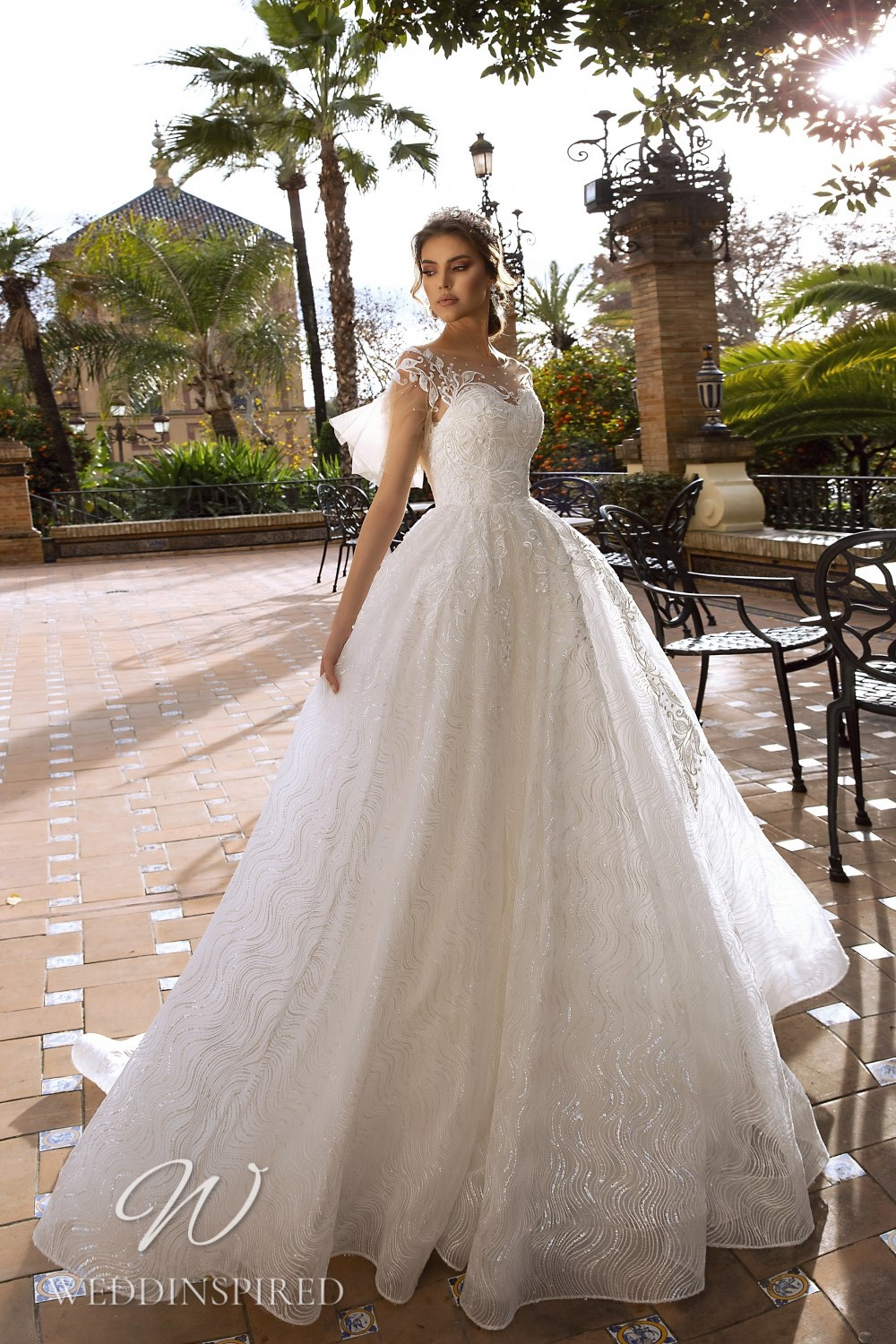 A Maks Mariano lace and tulle princess wedding dress