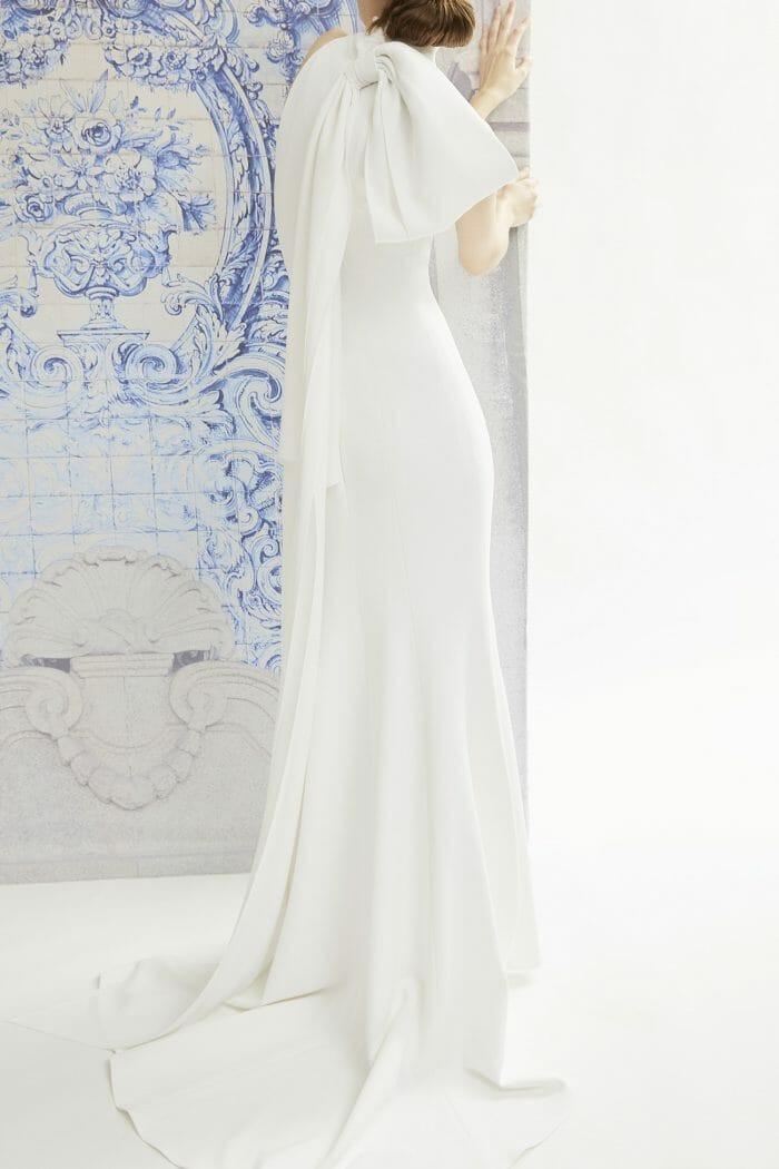 A Carolina Herrera crepe sheath wedding dress with a bow