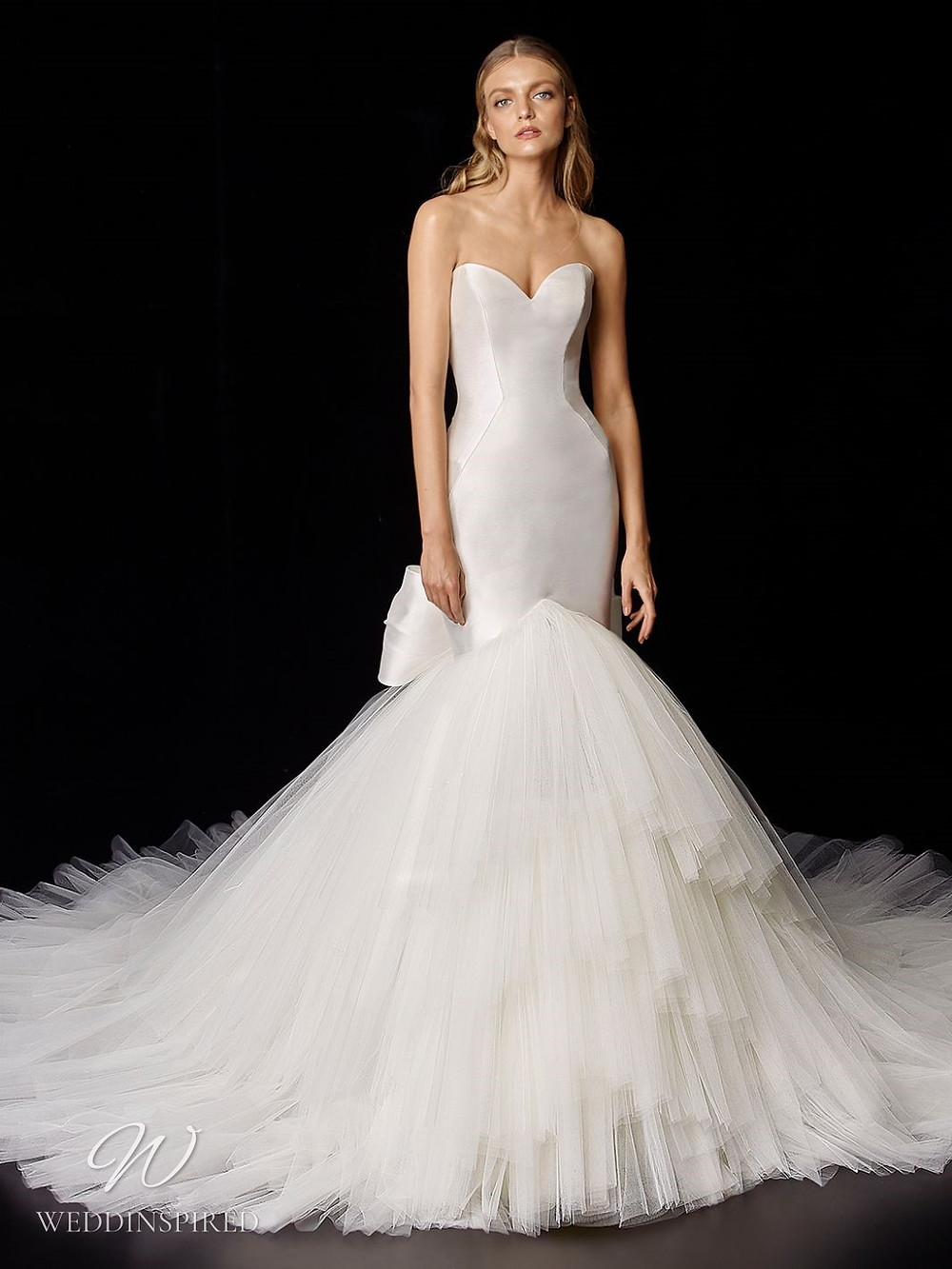 An Enzoani strapless silk mermaid wedding dress with a tulle skirt, a bow and a sweetheart neckline