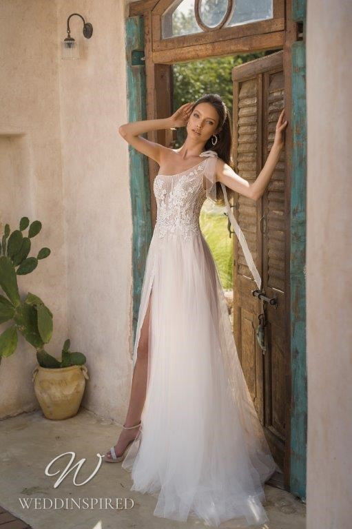 A David Hasbani ivory lace and tulle one shoulder A-line wedding dress