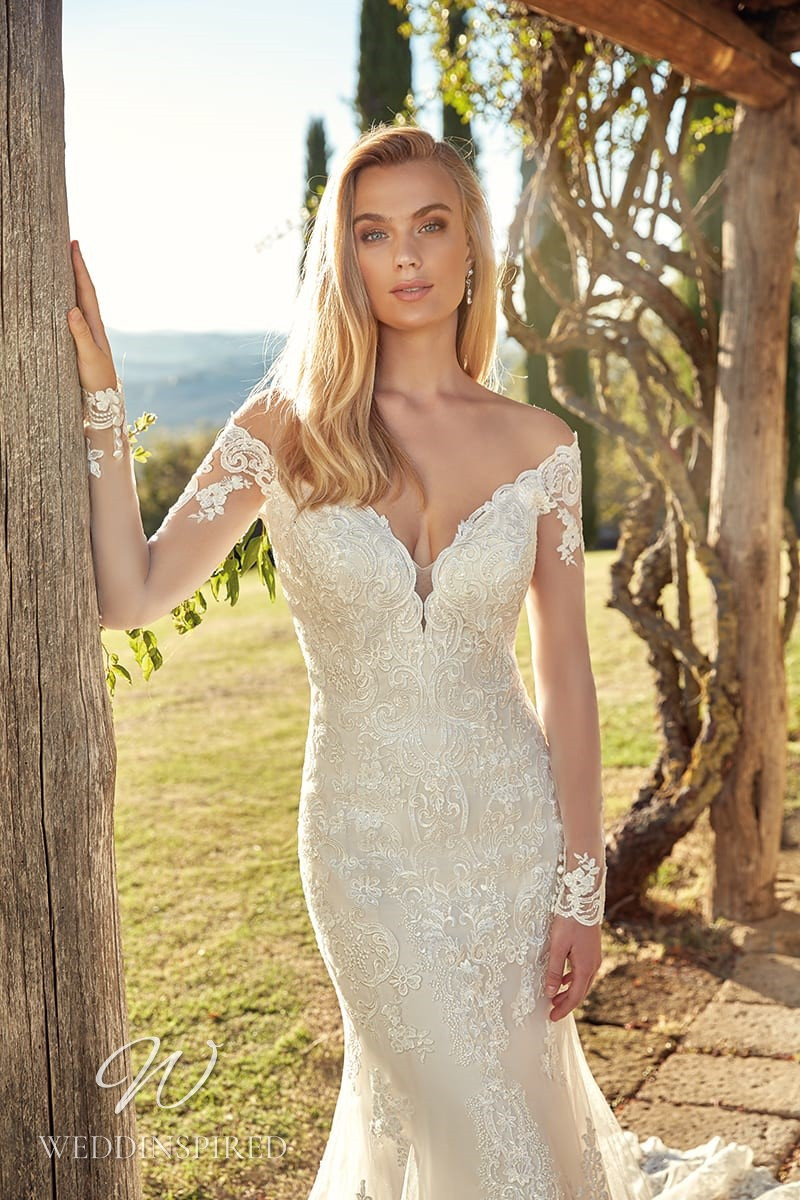 An Eddy K 2021 lace off the shoulder mermaid wedding dress with long sleeves