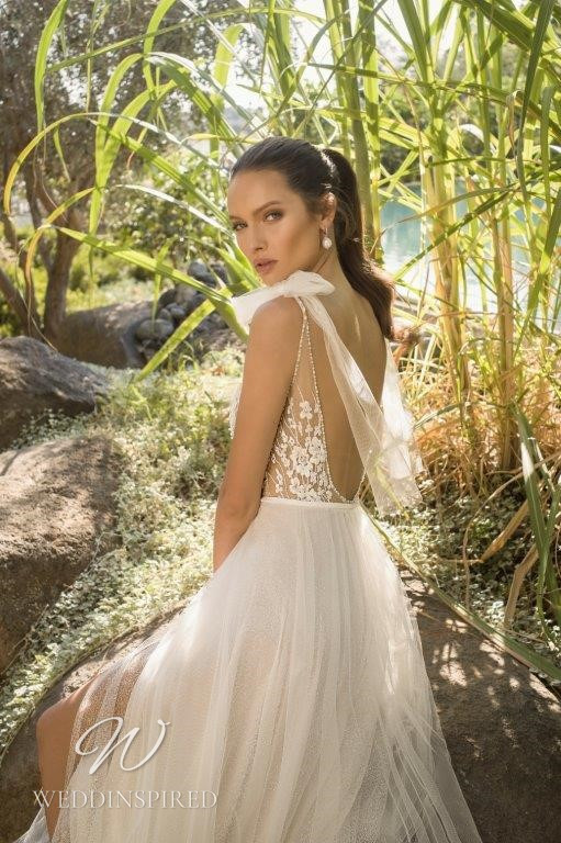 A David Hasbani ivory lace and tulle A-line wedding dress with a v neckline
