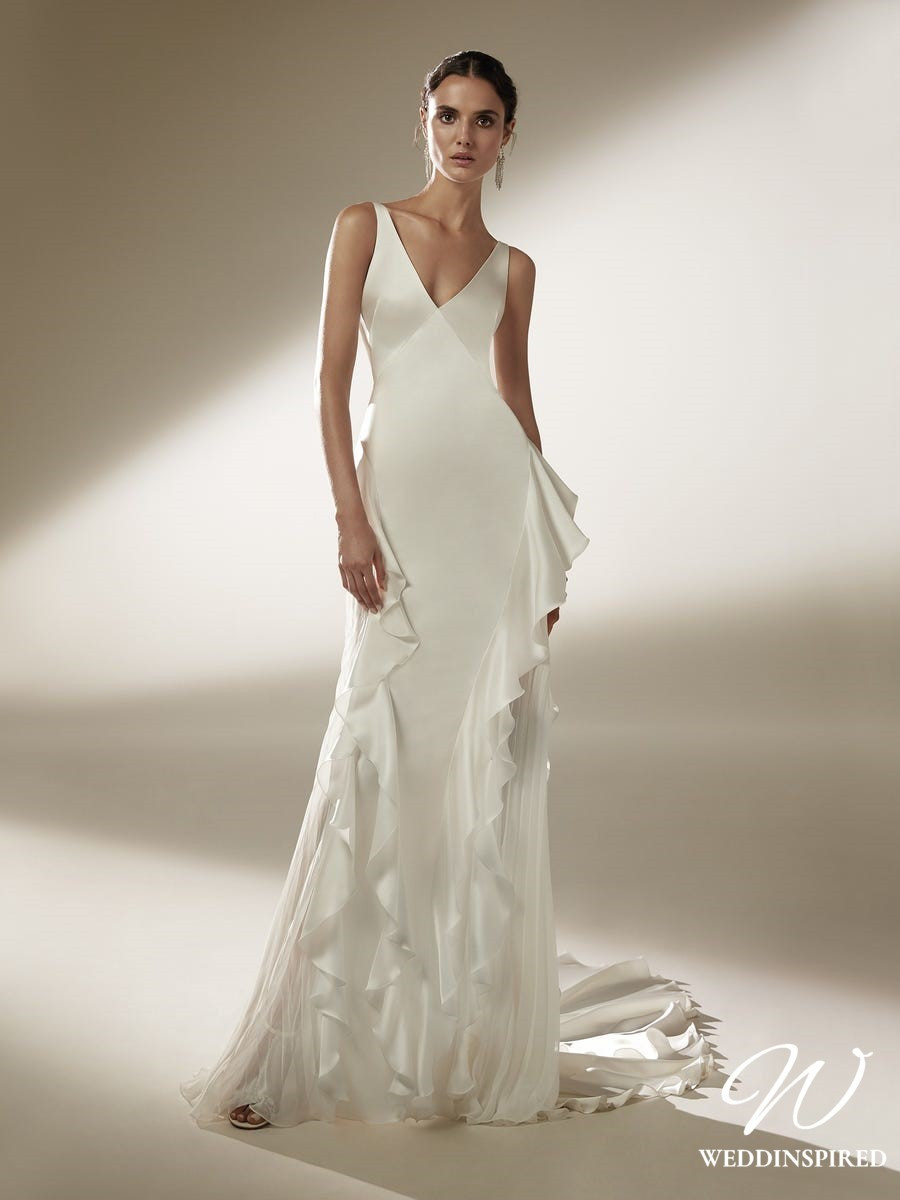 An Atelier Pronovias silk v neck sheath wedding dress with ruffles