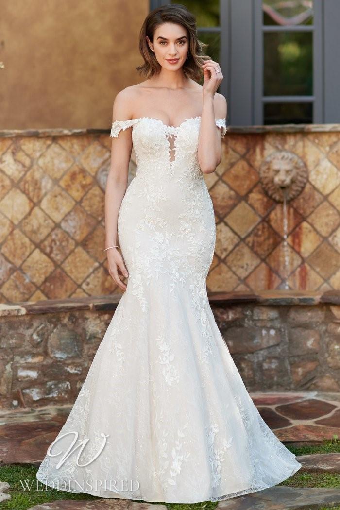 A Kenneth Winston 2021 lace off the shoulder mermaid wedding dress