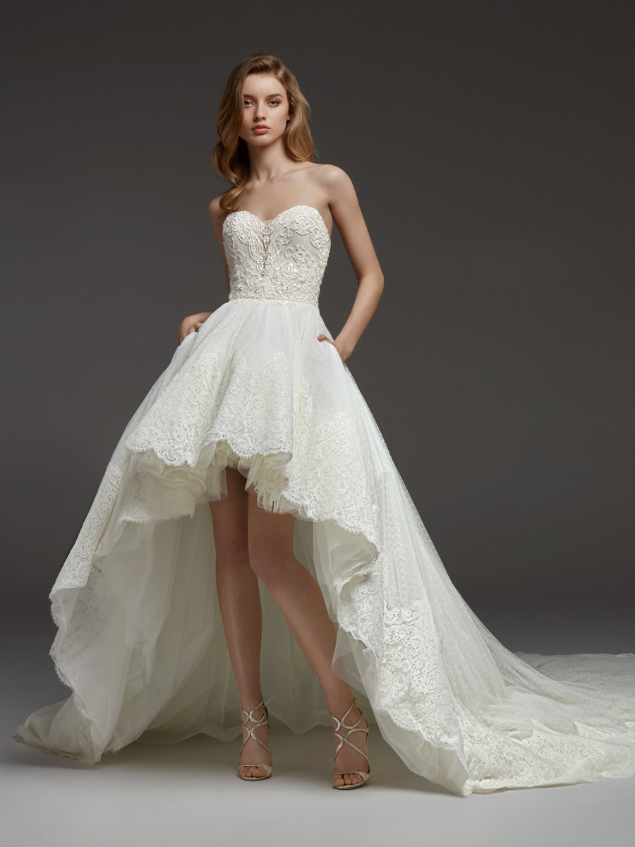 A Pronovias strapless lace high-low wedding dress with pockets and a sweetheart neckline