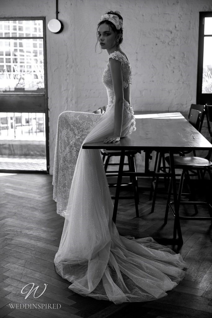A Julie Vino 2021 ivory champagne lace mermaid wedding dress with tulle detachable skirt