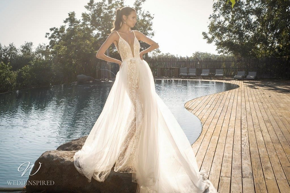 A David Hasbani ivory lace and tulle A-line wedding dress with a detachable skirt