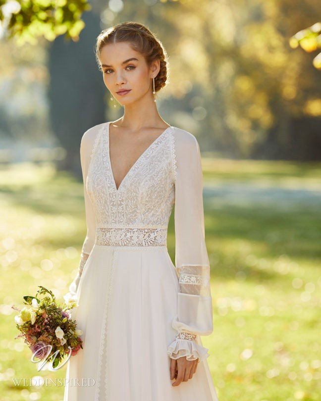 An Aire Barcelona 2021 boho lace A-line wedding dress with long sleeves and a v neck