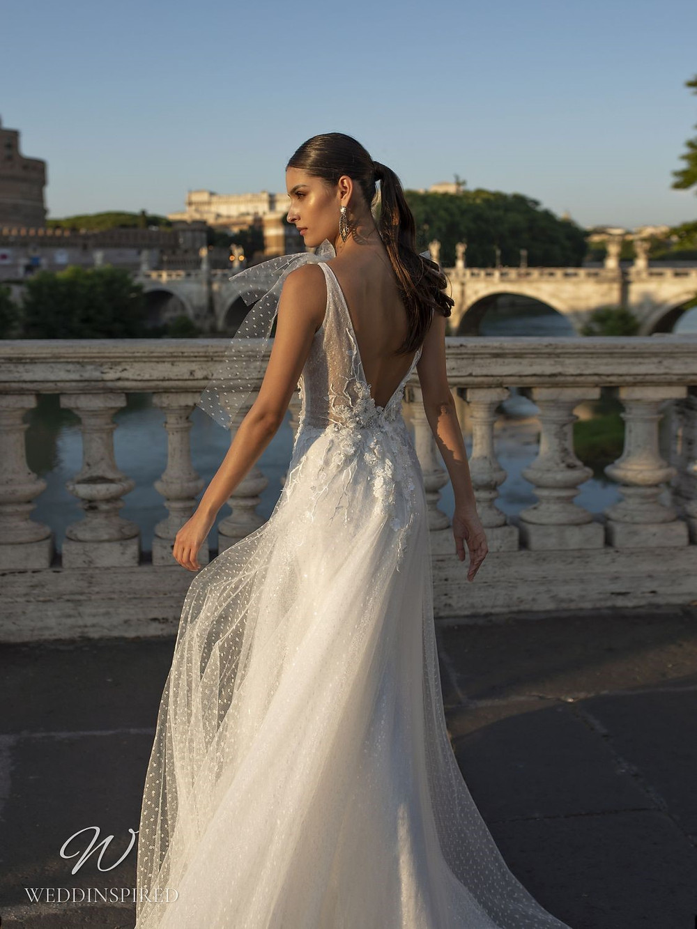 A Pinella Passaro tulle A-line wedding dress with a low back
