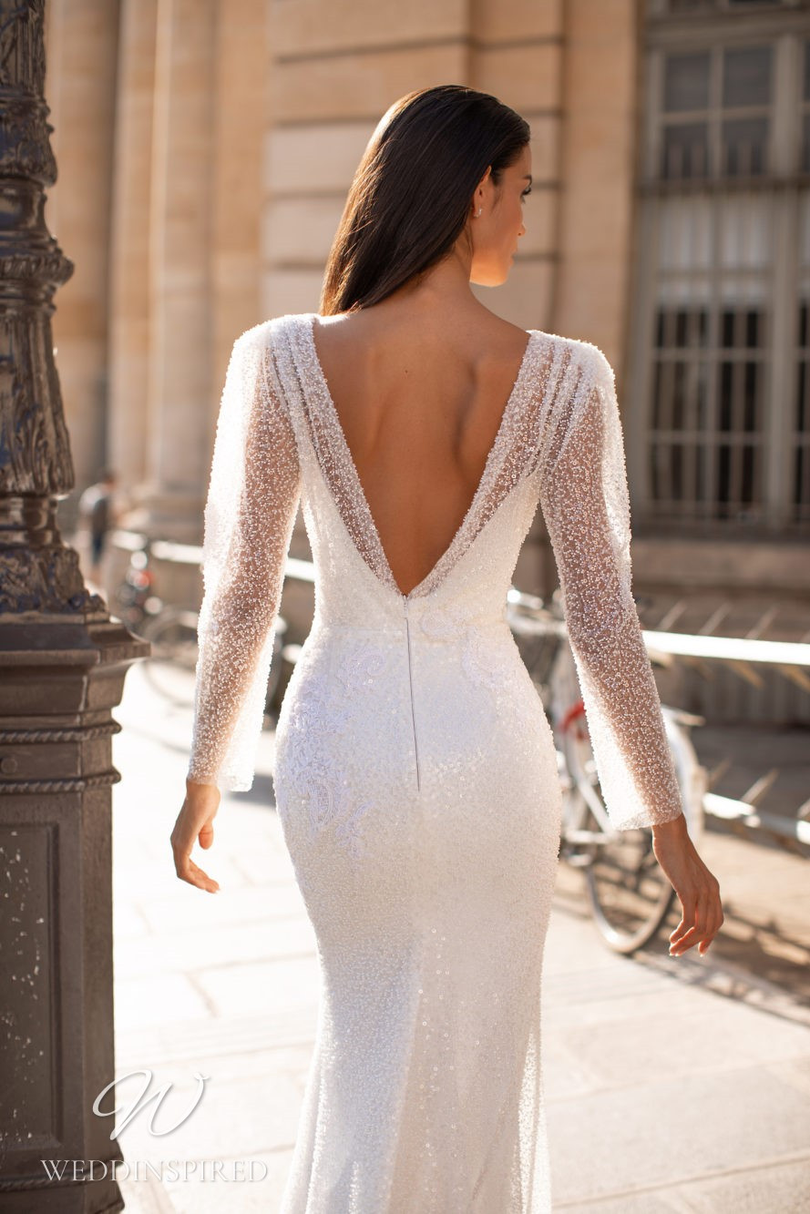 A Milla Nova sequin mermaid wedding dress with a low back and long sleeves